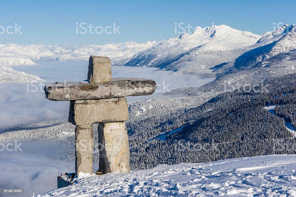 inukshuk on top of mountain. stock photo