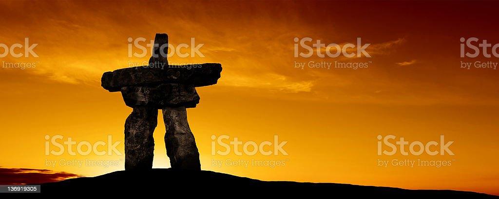 XXXL inukshuk silhouette stock photo
