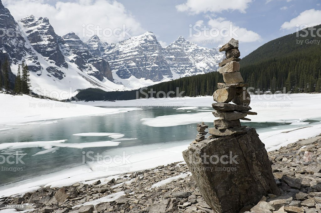 Inukshuk, stacked stones at Moraine lake stock photo