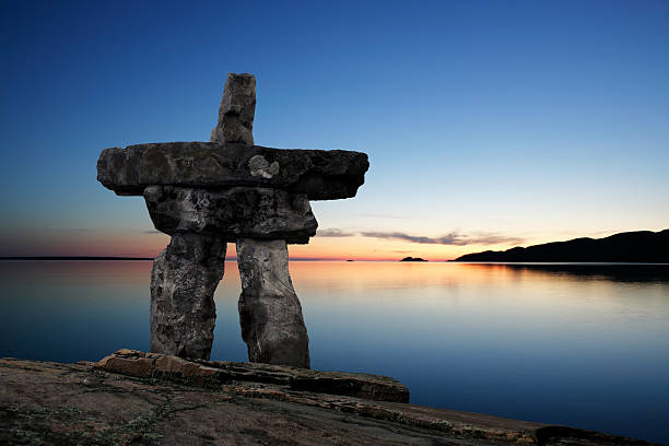 XL inukshuk twilight stock photo