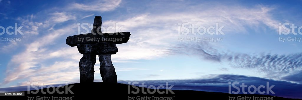 XXXL inukshuk twilight silhouette stock photo