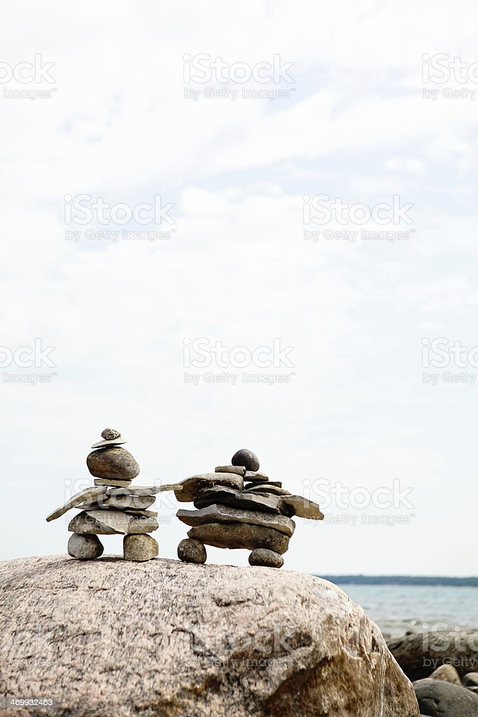 Inuksuit at the Beach royalty-free stock photo