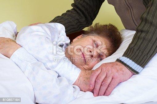istock Invalid elderly woman 810857164