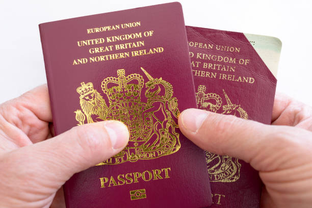 Invalidated Cut Corner UK Passport and New Replacement stock photo