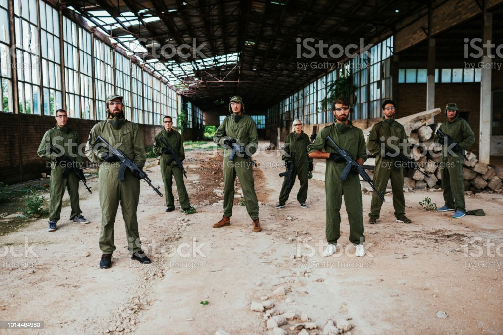 Invasion and riots in airsoft shooting game stock photo