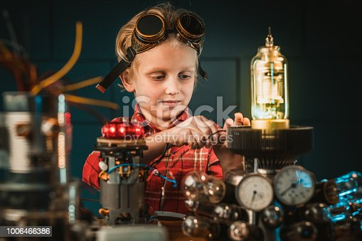 Young inventor working in his laboratory