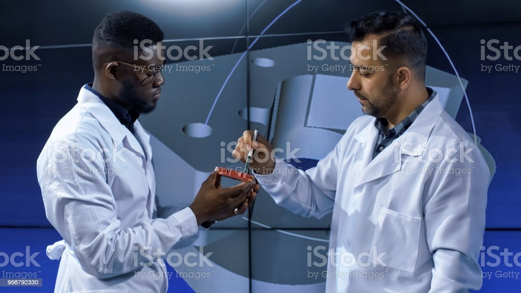 Inventors exploring 3-D printed item model stock photo