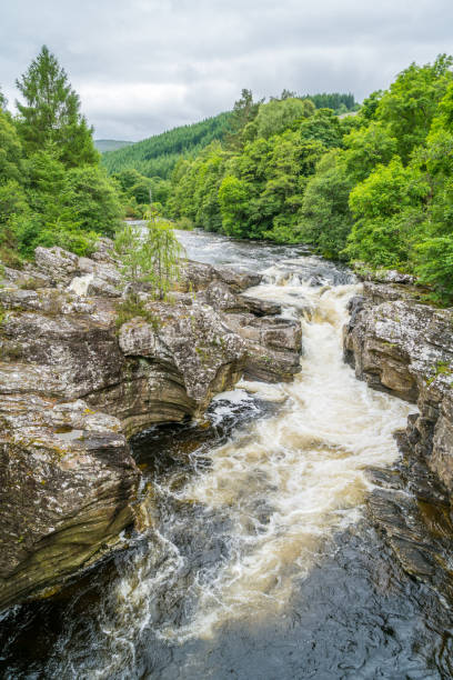 Invermoriston Falls near Fort Augustus, on Loch Ness, Scottish Highlands. Invermoriston Falls near Fort Augustus, on Loch Ness, Scottish Highlands. inverness scotland stock pictures, royalty-free photos & images
