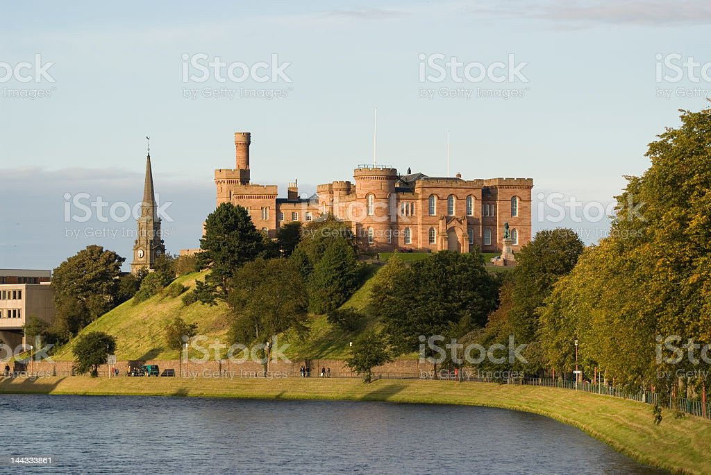 Inverness castle located along beautiful lake and hill stock photo