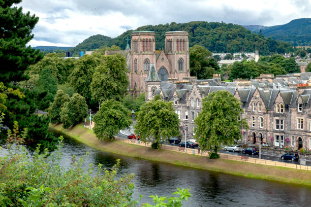 Inverness Cathedral and River Ness in Inverness, Scotland View from Castle Hill of the River Ness, downtown Inverness, and the Inverness Cathedral in Scotland inverness scotland stock pictures, royalty-free photos & images