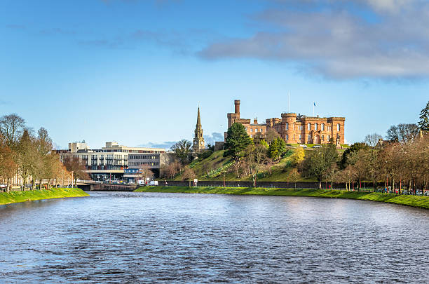 Inverness Skyline on a Winter Morning Photo of the River Ness with Inverness skyline in background on a clear winter morning. inverness scotland stock pictures, royalty-free photos & images