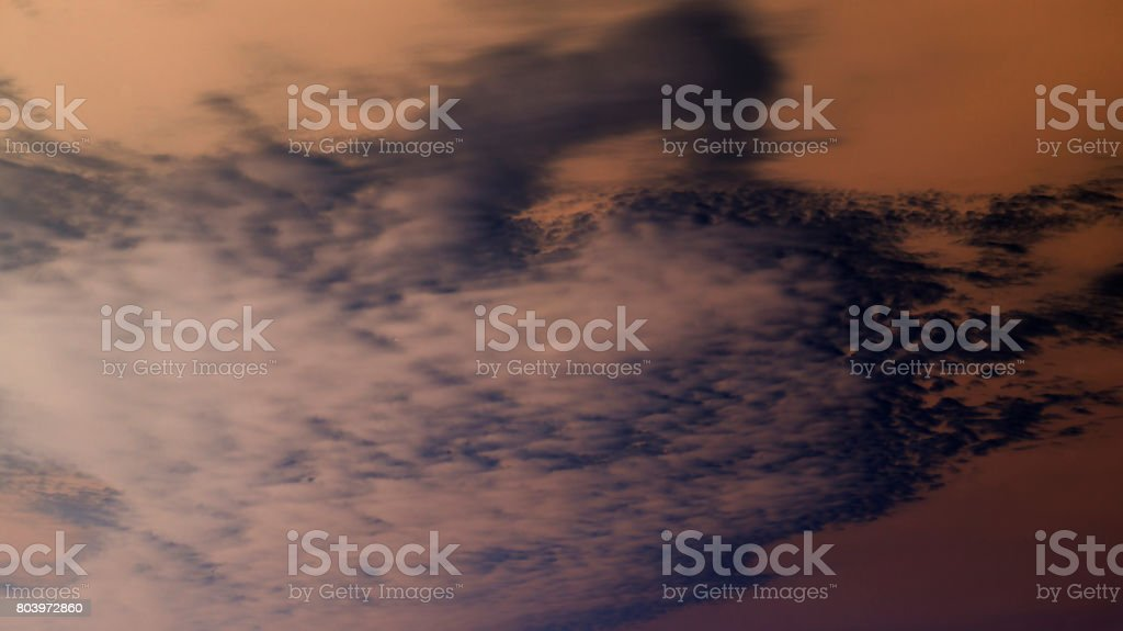 Inversion of the color of the cloudy sky. stock photo