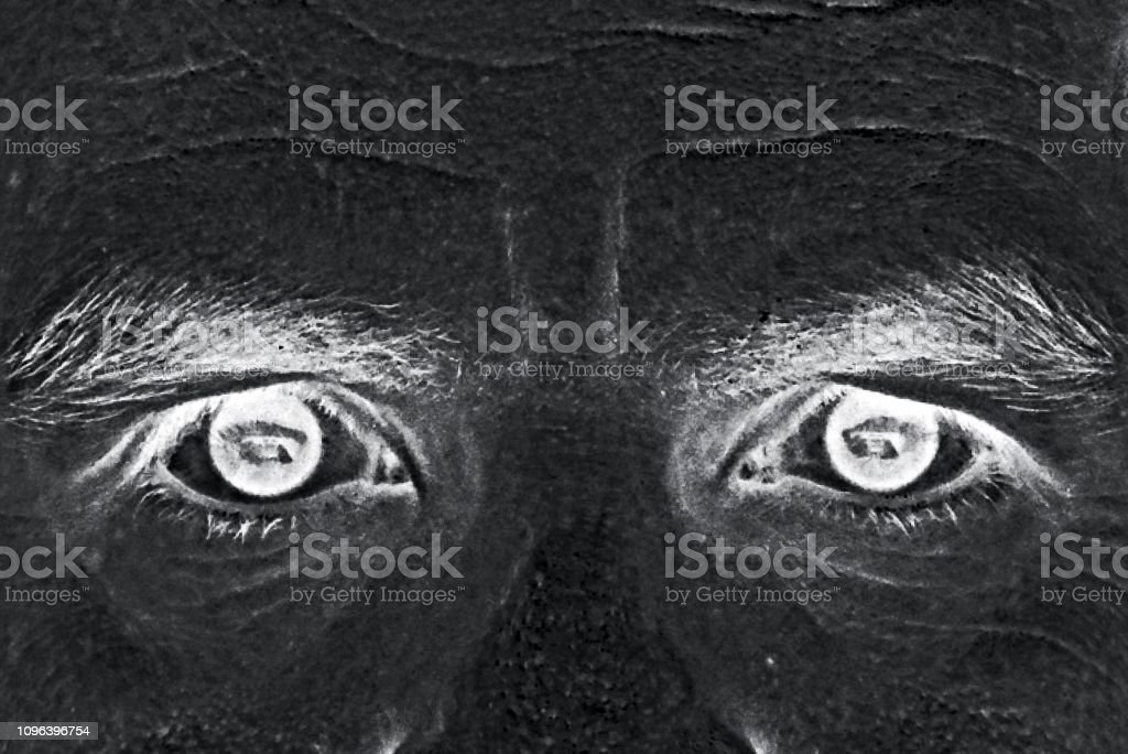 Inverted black and white eyes closeup stock photo