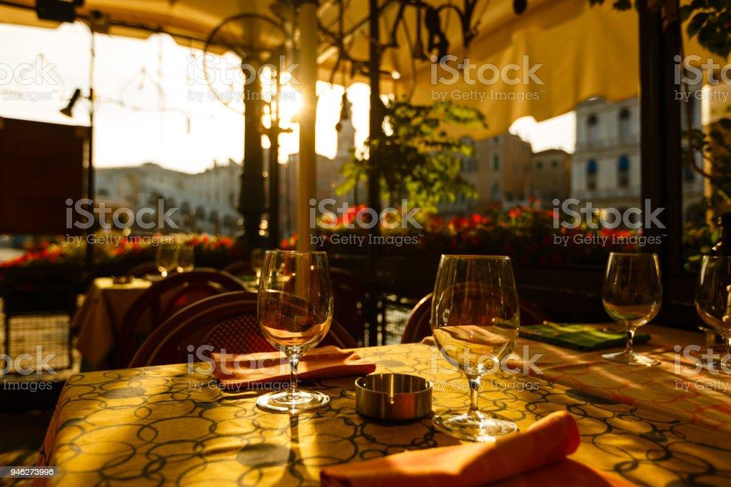 Inverted empty wine glasses on the table, dawn stock photo