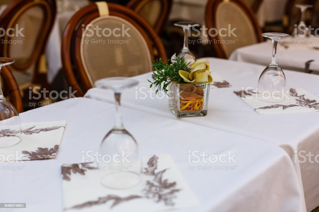 Inverted empty wine glasses on the table, toning stock photo