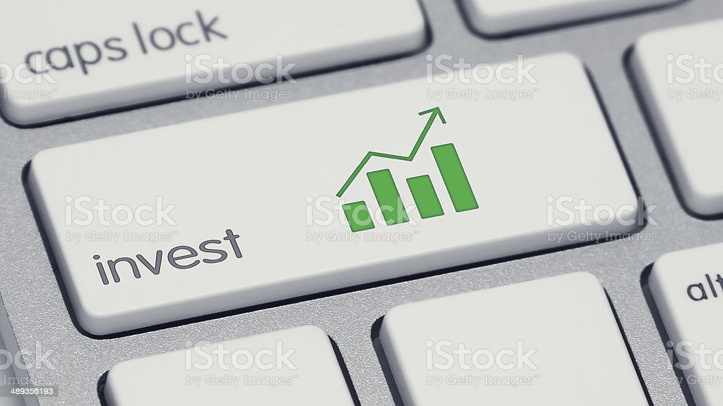 Invest Keyboard Button with Green Barchart stock photo