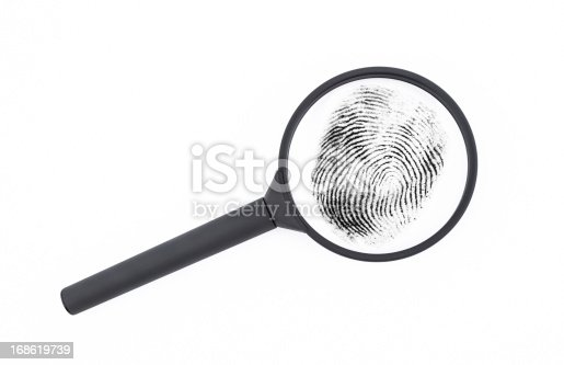 Classical black magnifying glass with double and quadruple magnification on white background investigating a fingerprint. Comfortable rubberized grip. Soft shadows. Photo made indoor with high quality equipment. Nikon D7000, Nikkor 16-85mm. Large copy space for your text.