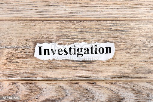 istock Investigation text on paper. Word Investigation on torn paper. Concept Image 857401840