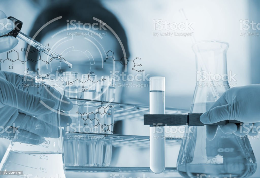 Investigator checking test tubes. Man wears protective goggles Conical flask in scientist hand with lab glassware background, Laboratory research concept AIDS Stock Photo
