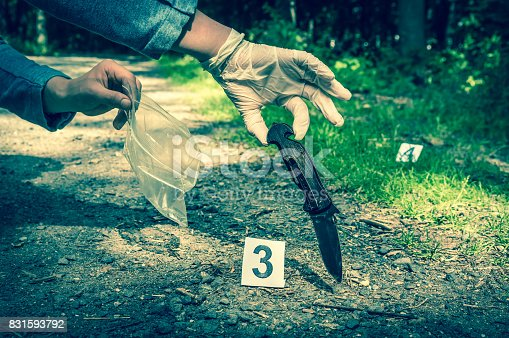 istock Investigator collects evidence - crime scene investigation 831593792