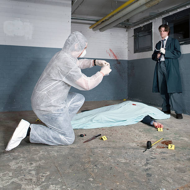 Investigators performing a crime scene investigation stock photo