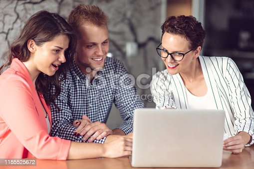 994164766 istock photo Investment adviser giving a presentation to a friendly smiling young couple seated at her desk in the office 1155525672
