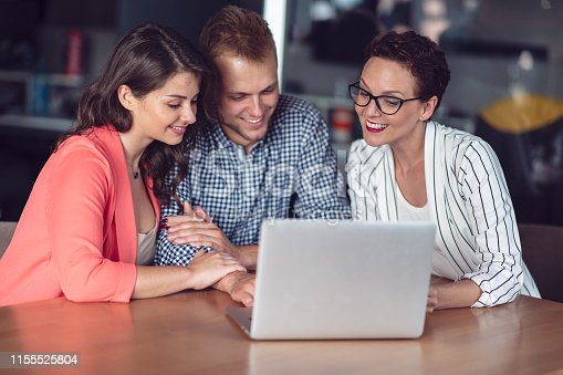 994164766 istock photo Investment adviser giving a presentation to a friendly smiling young couple seated at her desk in the office 1155525804