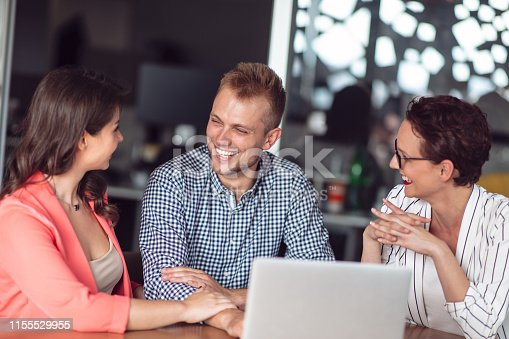 994164754istockphoto Investment adviser giving a presentation to a friendly smiling young couple seated at her desk in the office 1155529955