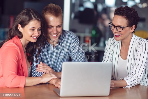 994164754istockphoto Investment adviser giving a presentation to a friendly smiling young couple seated at her desk in the office 1155531771
