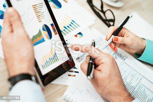 istock Investment advisors discussing about financial markets 692021788