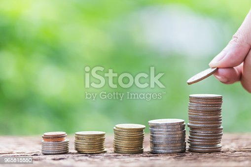 istock Investment and financial concept, Close up of stacking coins of growth to profit finance. 965815550