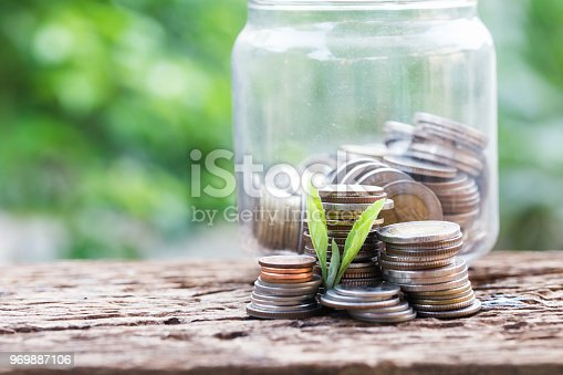 istock Investment and financial concept, Close up of stacking coins of growth to profit finance. 969887106