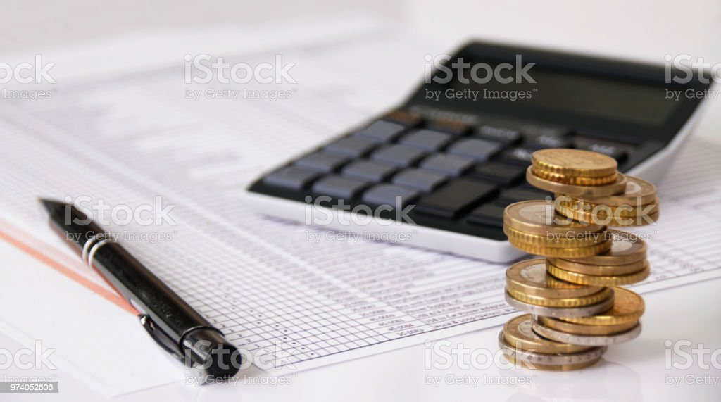 Investment Banking and finance, money, calculator and coins