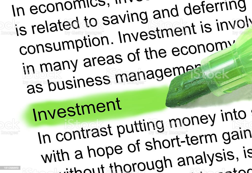 investment definition marked in dictionary stock photo