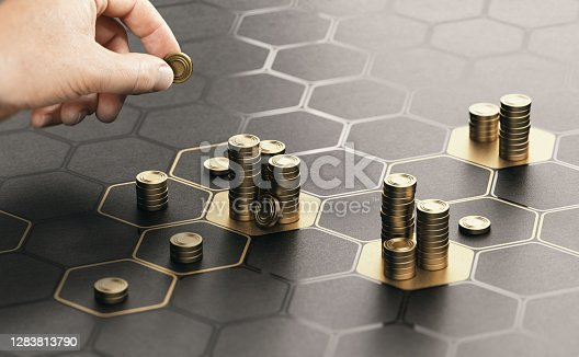 Human hand stacking generic coins over a black background with hexagonal golden shapes. Concept of investment management and portfolio diversification. Composite image between a hand photography and a 3D background.