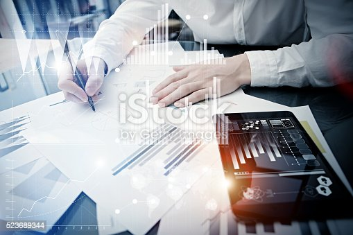 533699494istockphoto Investment manager working process.Concept photo trader work market report 523689344