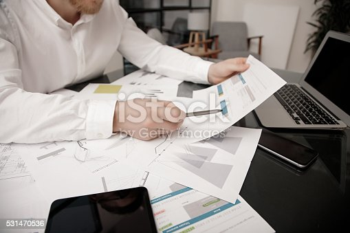533699494istockphoto Investment manager working process.Photo bank trader work market analyze 531470536