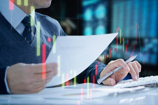 Investment risk management analysis Businessman or analyst working in the office pushing computer keyboard reviewing return on investment, ROI, and some information on routine work. enter key stock pictures, royalty-free photos & images