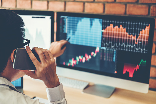 Investment stock market  Entrepreneur Business Man discussing and analysis graph stock market trading,stock chart concept