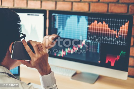 1131299321 istock photo Investment stock market  Entrepreneur Business Man discussing and analysis graph stock market trading,stock chart concept 1131299321