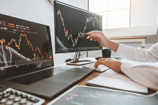 Investment stock market Entrepreneur Business team discussing and analysis graph stock market trading,stock chart concept Investment stock market Entrepreneur Business team discussing and analysis graph stock market trading,stock chart concept seller stock pictures, royalty-free photos & images