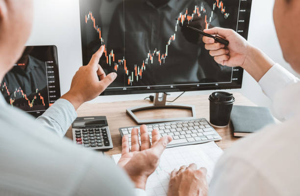 Investment stock market Entrepreneur Business team discussing and analysis graph stock market trading,stock chart concept stock photo