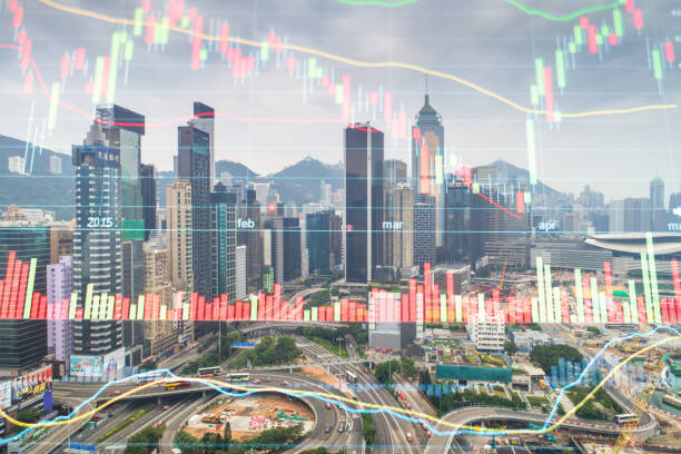 investment theme background with aerial panoramic view of the Hong Kong City Skyline and Victoria Harbour at sunset at china stock photo