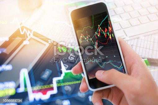 865596966istockphoto Investment theme stockmarket and finance business analysis stockmarket with digital tablet 1056689234