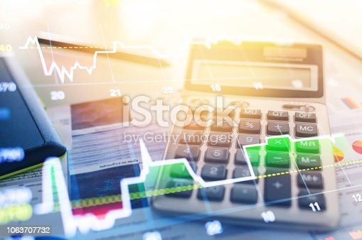 1061121998istockphoto Investment theme stockmarket and finance business analysis stockmarket with digital tablet 1063707732