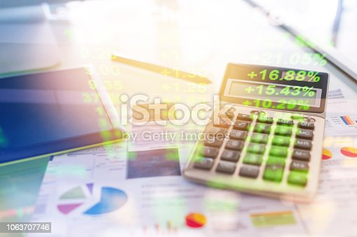 865596966istockphoto Investment theme stockmarket and finance business analysis stockmarket with digital tablet 1063707746