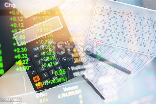 istock Investment theme stockmarket and finance business analysis stockmarket with digital tablet 1063728530