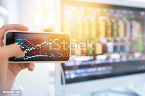 istock Investment theme stockmarket and finance business analysis stockmarket with digital tablet 1064142940