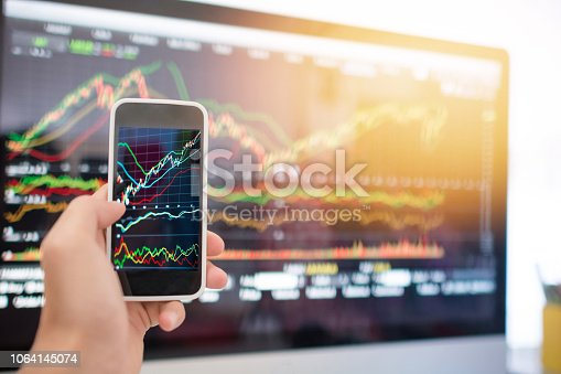 865596966istockphoto Investment theme stockmarket and finance business analysis stockmarket with digital tablet 1064145074