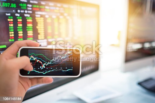 865596966istockphoto Investment theme stockmarket and finance business analysis stockmarket with digital tablet 1064145184